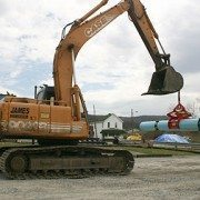 Kenco Pipe Lift Attached to the Lift Eye of Excavator Bucket