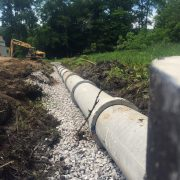 Merritt Construction laying 18 inch concrete pipe