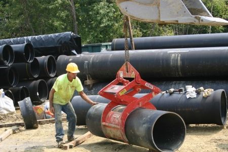 Wright Worker Helping to Guide the Direction of Pipe Using Pipe Lift