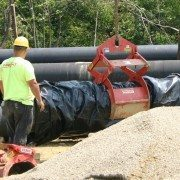 Wright Using Pipe Lift on Wrapped Pipe