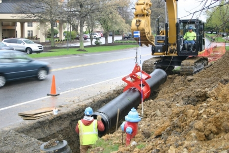 Thomas Construction Setting Pipe with the Kenco Pipe Lift
