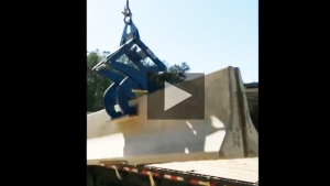 Unloading Barrier Wall from Truck