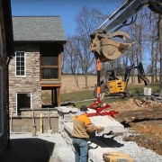 Placing capstone on retaining wall