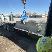 Loading barrier wall onto truck