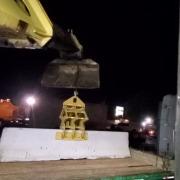 setting barrier on truck